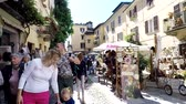 ORTA SAN GIULIO, ITALY - 17 SEPTEMBER 2017: People walking along narrow street on Orta San Guilio, Camera movement. Wideo