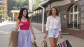 aviador : Two beautiful women go on the street after a successful shopping 4k and slow motion Stock Footage