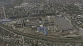 駅 : Drone. View from above. In the middle of the city is an old factory.