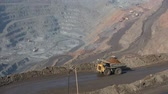 レイヤード : Quarry with ore. Works appliances. Excavators and BelAZ. In the frame, BelAZ passes, filled with ore.