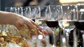 guloseima : Delicious buffet table. Female hand takes a glass of white wine. 4K Slow Mo Stock Footage