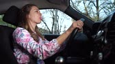 attentiveness : A woman driving in a good mood inflates chewing gum. 4K Slow Mo