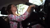 attentiveness : The woman behind the wheel, fun dancing and singing. 4K Slow Mo