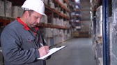 consignation : The employee rewrites the goods in the logistics warehouse. 4K Slow Mo