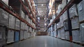 consignation : Logistics warehouse. Camera in motion. On the shelves are flying with goods. 4K Slow Mo