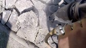 heavy : Roadworks construction workers using a jackhammer to break pavement and concrete slow motion