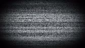 analog : Static tv noise caused by bad signal reception, black and white. Turning TV on and off