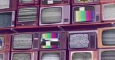 analog : Wall of old wooden TV screens with test signal and black and white static noise caused by bad signal reception
