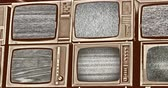 analog : Wall of old wooden black and white TV screens, static noise caused by bad signal reception