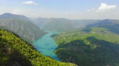 serbia : Aerial View. Flying over the beautiful lake and mountain, sunny day. Aerial drone shot. Landscape panorama. Tara and lake Perucac, Serbia