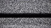 передача : Static tv noise caused by bad signal reception, black and white. Стоковые видеозаписи