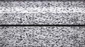 аналог : Static tv noise caused by bad signal reception, black and white. Стоковые видеозаписи
