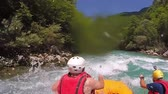 vor : People in boat enjoy on whitewater rafting trip on Tara river in Montenegro, slow motion