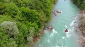 kuvvet : Aerial shot of people in boats whitewater rafting trip on Tara river in Montenegro, two boats