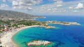 Aerial view of beautiful sandy beach, people sunbathing and swimming. Drone shot flying over Kalamitsi beach in Sithonia, Greece Wideo
