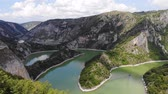 Aerial view meanders of river Uvac. Viewpoint, young woman enjoying in beautiful panorama, sunny day. Aerial drone shot, landscape panorama. River and lake Uvac in Serbia