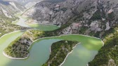 Aerial view meanders of river Uvac. Flying over the beautiful river and mountain, sunny day. Aerial drone shot, landscape panorama. River and lake Uvac in Serbia