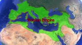 граница : Roman Empire boundaries. Imperial on 3D rotating old historic world map. Gigantic christian crusader state in middle age. Historical mapping border moving animation. Стоковые видеозаписи