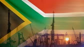 Industrial concept with South Africa flag at sunset