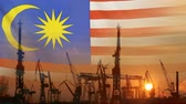 Industrial concept with Malaysia flag at sunset Dostupné videozáznamy