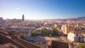 malagueta : spain sunny malaga city alcazaba castle cathedral square view 4k time lapse