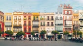 time : sunny day seville colored buildings and scooter parking 4k time lapse spain