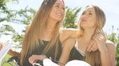 closeness : female twins having fun in the sun. dust and leaks. hd