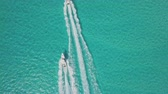 drone bird view of 2 boats in the bahamas. summer vaction