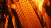 Closeup on birch logs burning in indoor open fireplace in slow motion hd. Burning logs with soft warm orange beautiful relaxing flames. Stock Footage