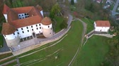 Aerial: flying around castle of city Sevnica beside river Sava in Slovenia. Beautiful small city with castle is the birth place of first lady Melania Trump.