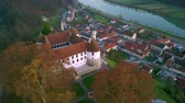 pó : Aerial: flying around castle of city Sevnica beside river Sava in Slovenia. Beautiful small city with castle is the birth place of first lady Melania Trump.