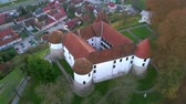 fame : Aerial: flying around castle of city Sevnica beside river Sava in Slovenia. Beautiful small city with castle is the birth place of first lady Melania Trump.