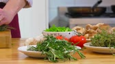 thyme : Pan over various bowls and dishes with herbs, spices and other ingredients, ending at a chef, choping up thyme on a cutting board Stock Footage