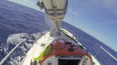 такелаж : Small 30 feet yacht,  sailing upwind over the Atlantic Ocean,  seen from the boom