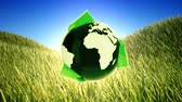 reciclagem : Recycling planet on green field background.