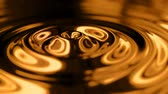 movimento circular : Animation of abstract ripples in shiny malleable gold forming concentric rings around a central droplett.