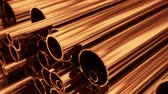 fornecimento : Close up on stack of copper pipes. Loopable animation.
