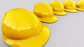Loopable animation of yellow safety helmets shaping the circle. Wideo