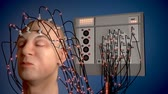 Man wired to an EEG machine or electroencephalograph which produces a graphical record of electrical activity of the brain Wideo