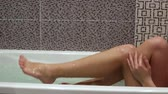 Girl taking a bath Stock Footage