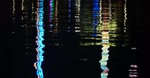 Reflective Nightlights on a Water Surface at the Kiel Week Festival in Germany