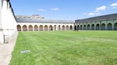 arc : Next to the cathedral of Orleans, in French town, there is a cloister called Campo Santo. It is a green space in the heart of a historical monument dating from the 12th century. Stock Footage