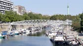 arsenal : Paris, in summer, in a district to the east of the city, called Bastille. The port of the arsenal is a very popular place for Parisians who come to rest next to the boats. Stock Footage