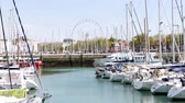 сессия : In the city center of La Rochelle, a town in the west of France, located in the department of Charente-Maritime. Theres a wheel behind the old port.