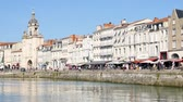 new aquitaine : City center of La Rochelle, a seaport on the Atlantic coast in western France. Its a street near the old port. Filmed during the summer.
