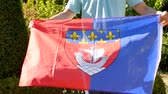 The flag of Paris is a blue flag of Paris, blue and red, both of which feature in the citys coat of arms. Flag is holding by someone.