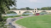 Time lapse in Avignon, France. The Pont dAvignon is a famous medieval bridge in the city. Cars are passing under the arch of the bridge. The bridge is also called Pont Saint-B?n?zet in french.
