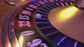 выиграть : Perspective close up view on Roulette Wheel in a casino