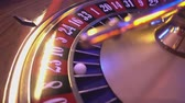 gamble : Roulette Wheel in a casino - ball in field 23 red Stock Footage