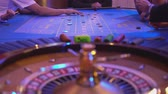 gamble : Roulette table in a casino - Gamblers put bets for new game Stock Footage
